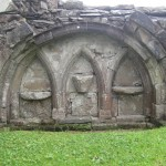 Three arch pointed recesses in the SE corner of the choir, with a piscina (wash basin for cleaning the vessels) in the centre.