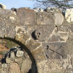 Skull and crossbone on entrance to Ardchattan Chapel (claimed to be smallest chapel in Scotland)